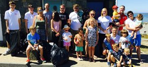 Guernsey employees undertake third beach clean
